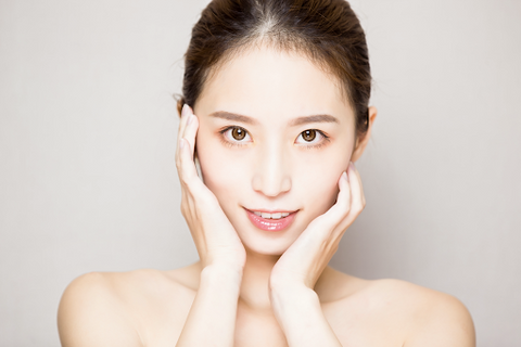 An asian woman with clear, healthy skin
