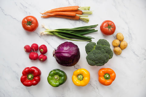 A healthy assortment of vegetables on a beautiful marble counter.