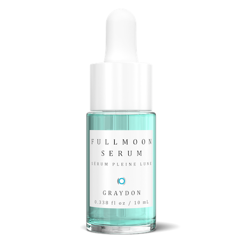 Fullmoon antiaging serum in glass bottle with blue liquid.