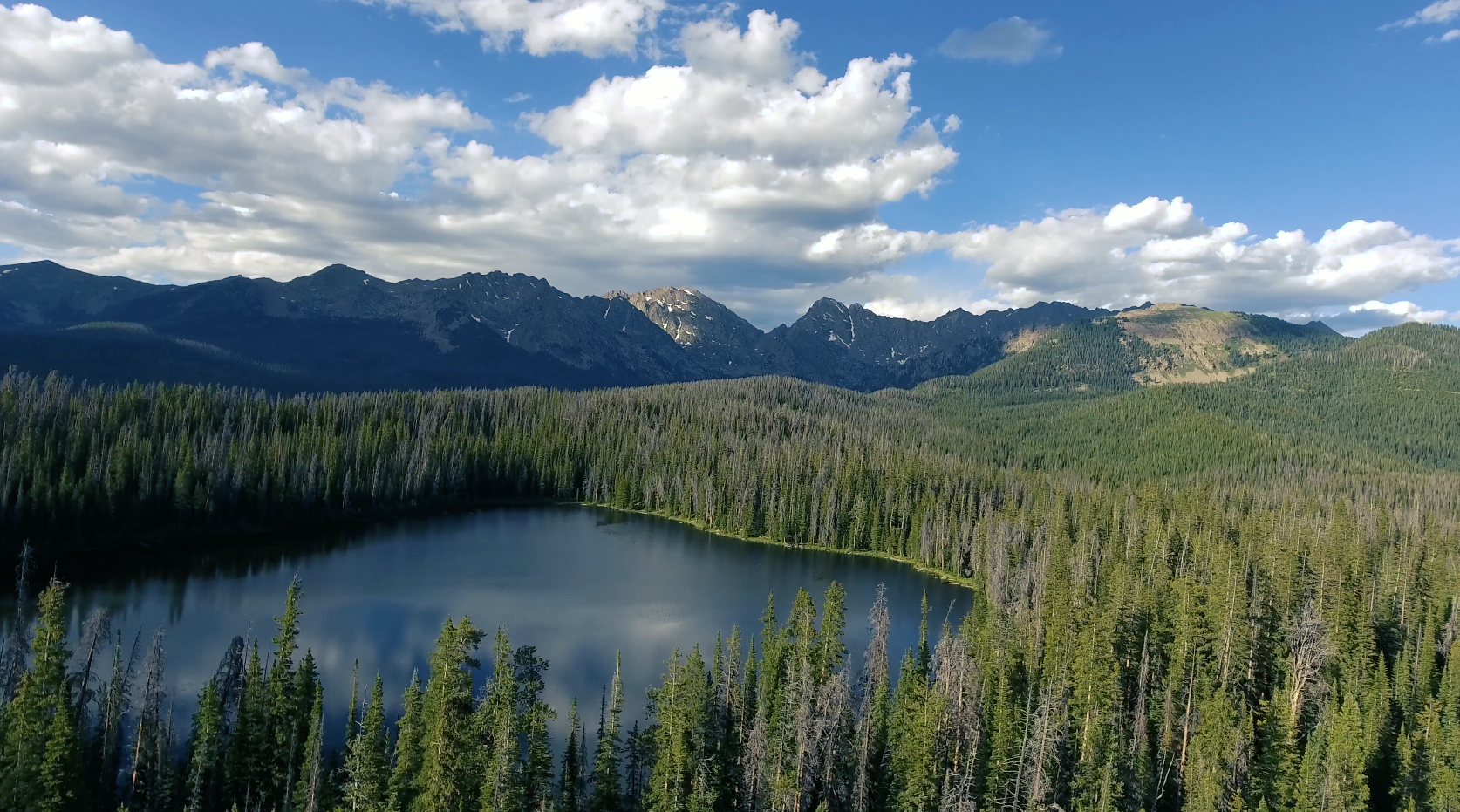 Free 4K Aerial Stock Video: Drone Flying Over Mountain Top Lake