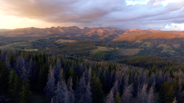 Free 4K stock video of a sunset drone flight through mountains