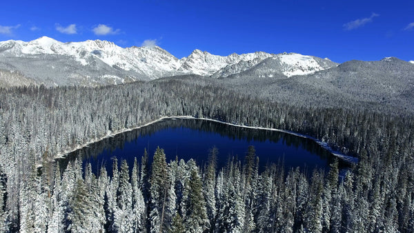 Free 4K Aerial Stock Video: Drone Flying over Snow Covered Lake