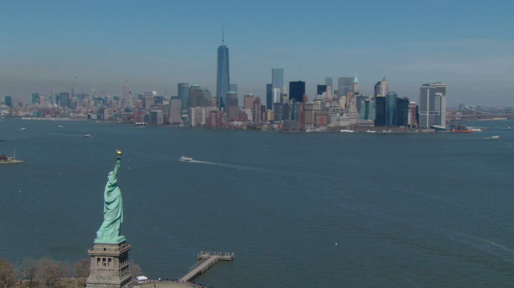 Free 4K aerial stock video of the Statue of Liberty and NYC Skyline stock footage