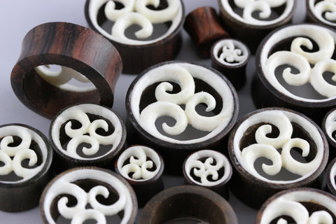 Hand Carved Bone and Wood Tunnels