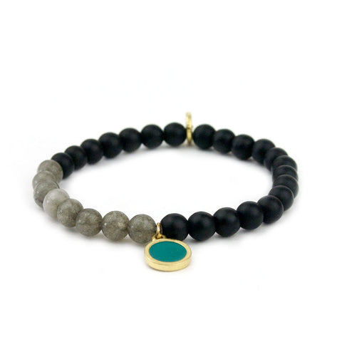 teal beaded bracelet with disc charm