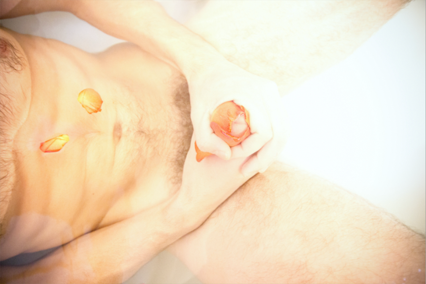 Naked Man in Bath with Petals