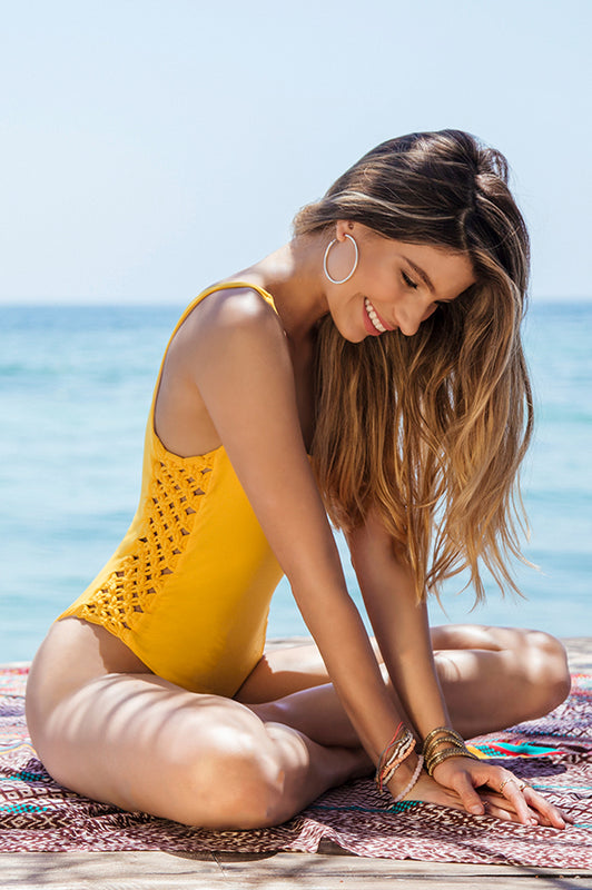 maylana high cut one piece features macrame detail at sides