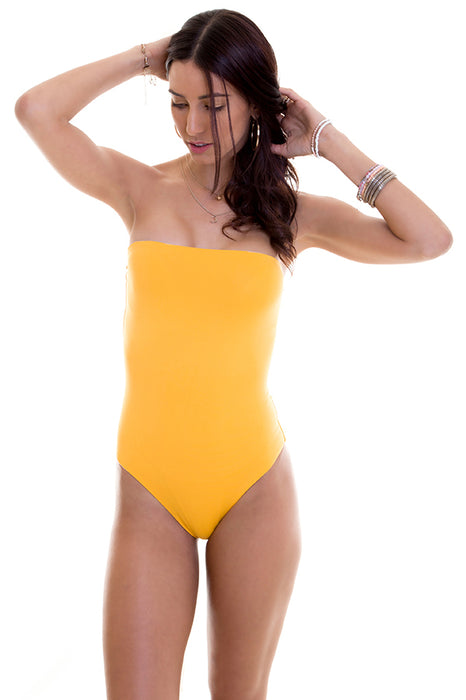 strapless one piece features moderate coverage at rear with solid print