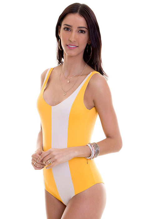 color block one piece features open back design with full coverage at rear