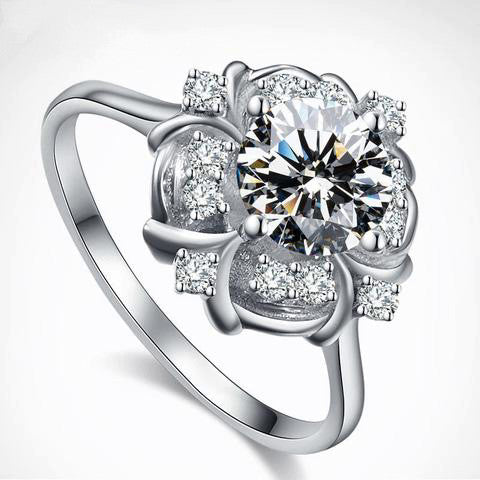 Gorgeous 1 Carat Moissanite Ring set in 18K White Gold Flower