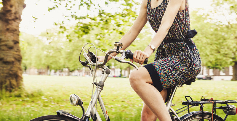 woman biking casually wearing a dress