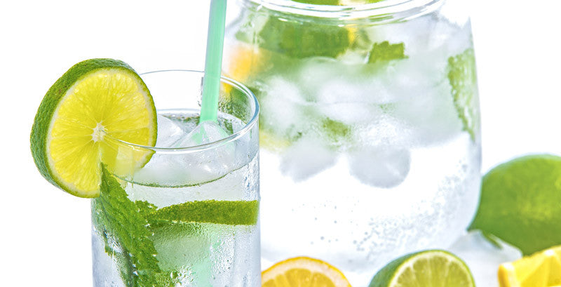 iced cold water that's infused with slices of mint plus lemon and lime slices