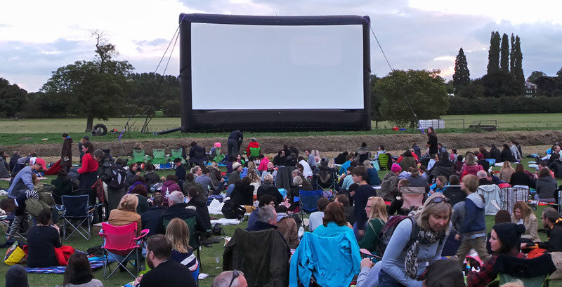 outdoor movie screening event where people are gathered
