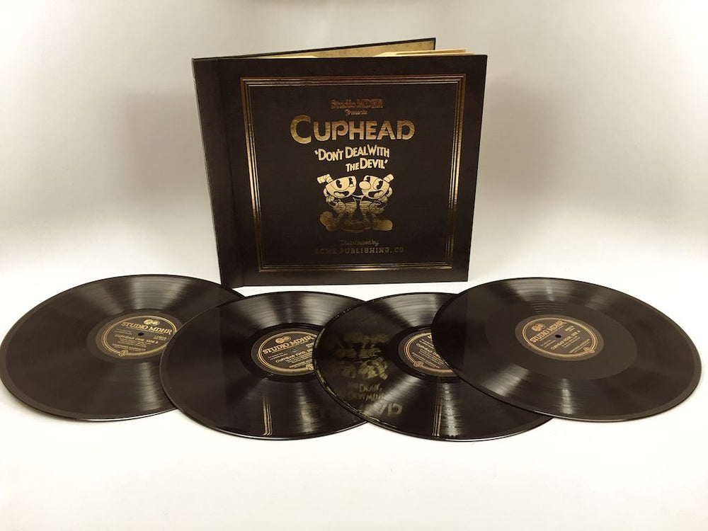 4 x Cuphead Vinyls in front of cover