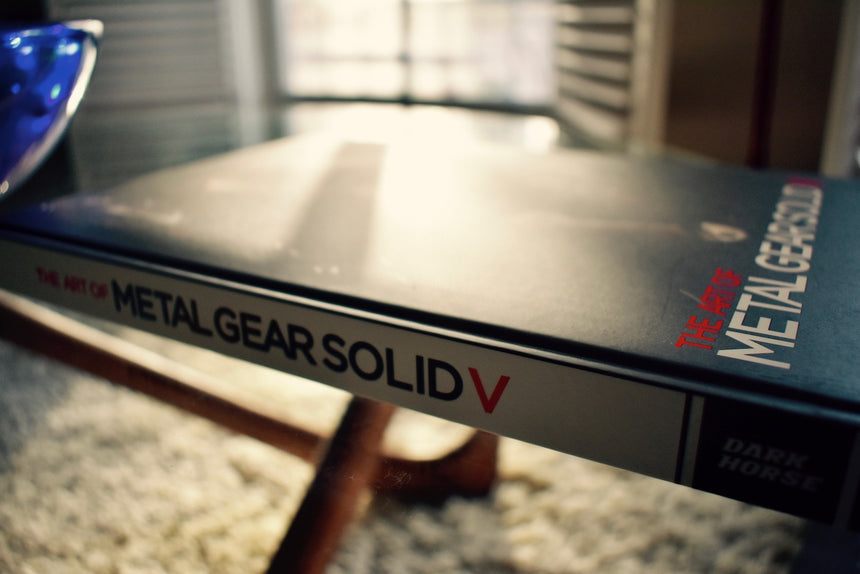 Metal gear solid 5 book on coffee table