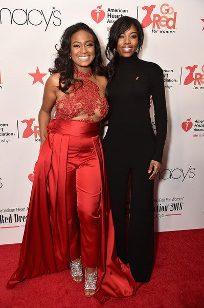 Actress Tatyana Ali (L) and Taneasha Prunty attend the American Heart Association's Go Red For Women Red Dress Collection 2018 presented by Macy's at Hammerstein Ballroom on February 8, 2018 in New York City.