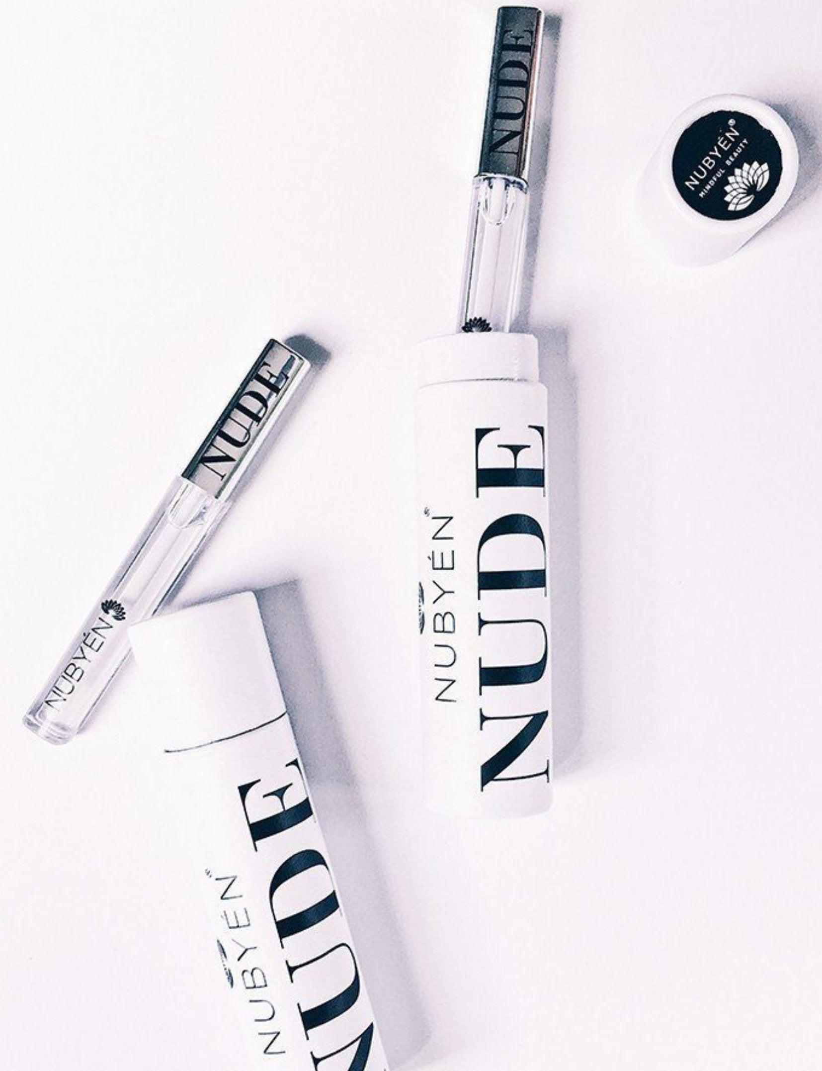 This Lip plumping gloss Nubyen Nude, its our best selling vegan and cruelty free gloss for fuller lips instantly, has natural ingredients such as collagen & hyaluronic acid, best lip plumping lipgloss, best lip plumper, lip filler, full lips, lip injections, plump it, to faced lip injection, nubyen nude Charlotte tilbury collagen lip plumper, too faced lip injection, dior addict lip maximiser, code lip intense plumper, buxum lip plumper, plump it lip plumper