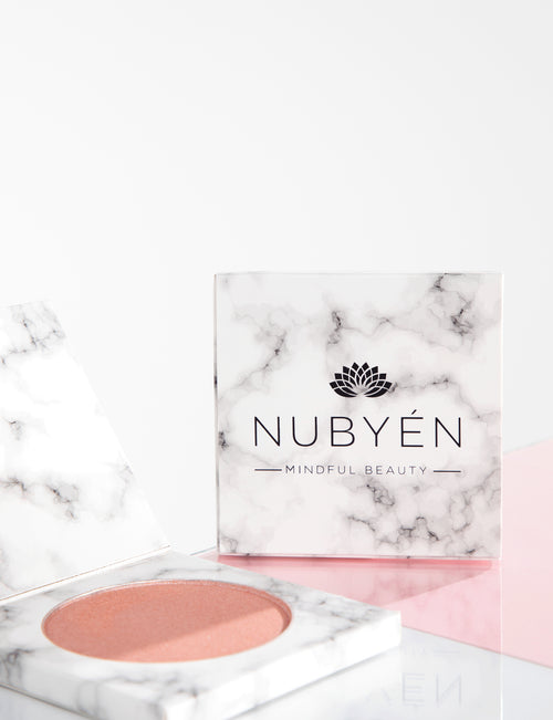 this is nubyen makeup highlighter, very hydrating and vegan and cruelty free. its a powder formulation and is long lasting.