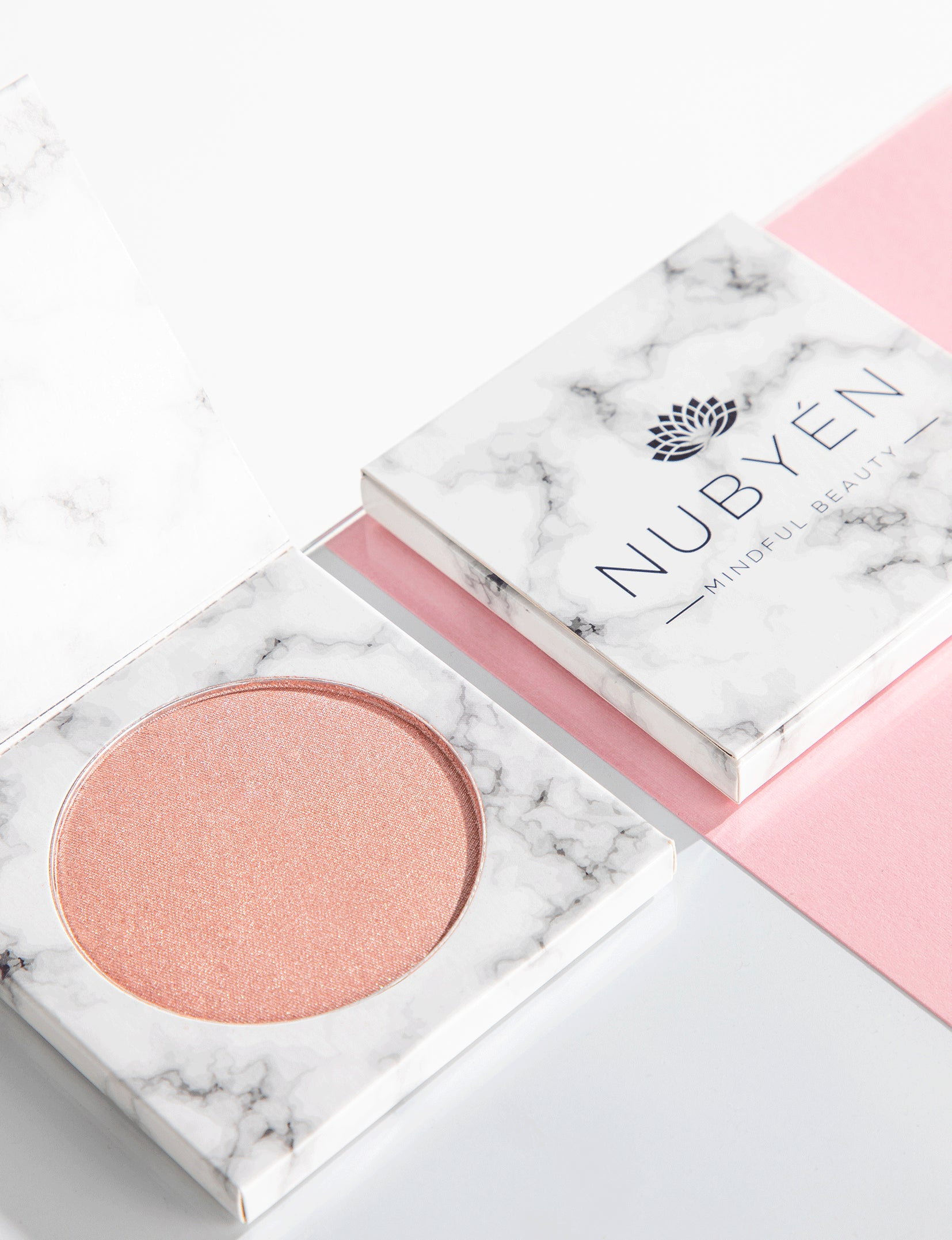 this is nubyen makeup highlighter, very hydrating and vegan and cruelty free. its a powder formulation and is long lasting. Nubyen highlighter, best highlighting powder, highlighter makeup, charlotte tilbury hollywood highlighter, too faced hoighlighter, glossier haloscope, sephora golden hour luminizing powder, becca shimmering perfector, fenty beauty killawatt freestyle highlighter