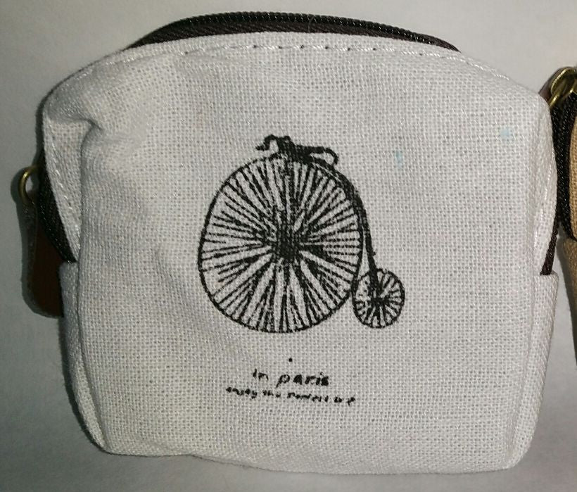 white zipper top bag w/ bicycle print