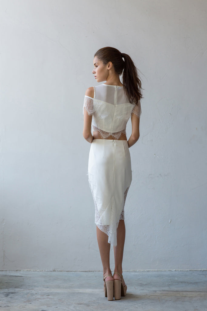 Fitted skirt with lace drape in cream