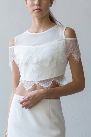 Off-shoulder cropped lace top in cream