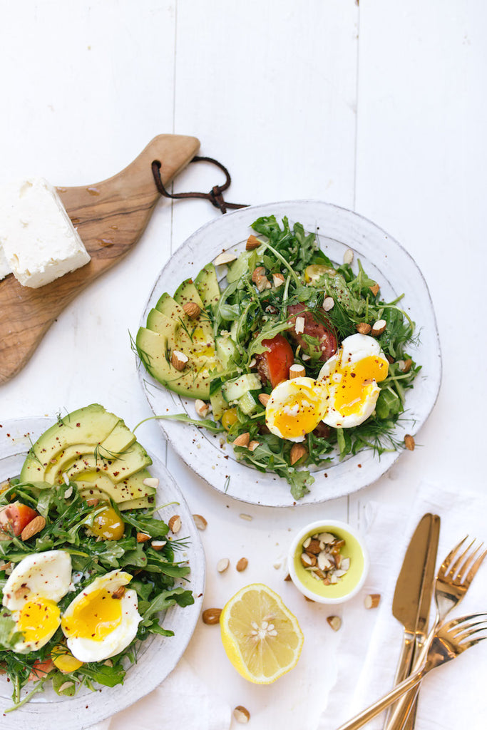brunch salad with soft boiled egg and avocado