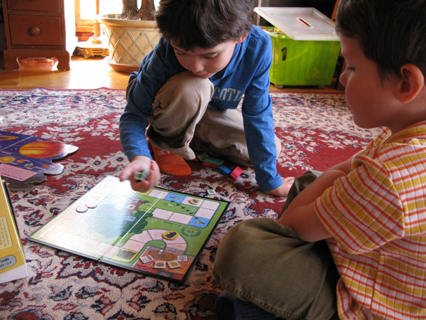Two young children enjoying working together in a game of Max (the Cat) Family Pastimes Co-operative Games
