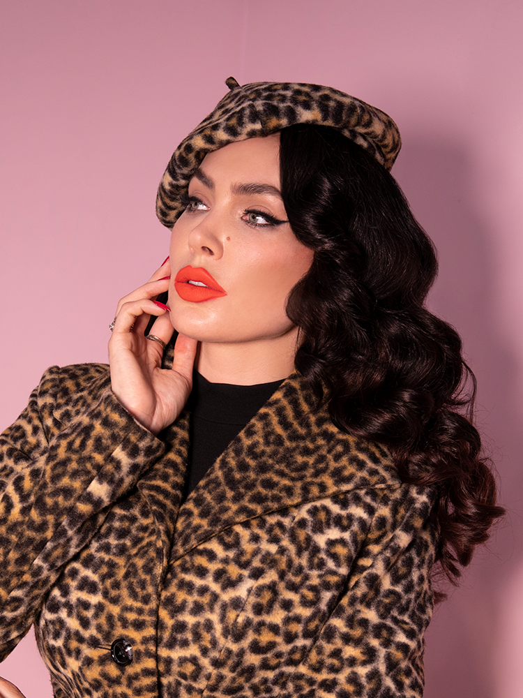 Close-up shot of Micheline Pitt wearing leopard print retro accessory beret.
