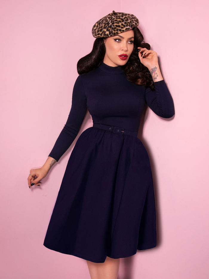 Bad Girl Swing Dress in Navy worn by Micheline Pitt who also is sporting a leopard beret.