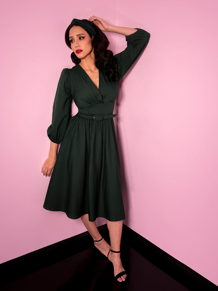 Full length image of Milynn Moon wearing the Vixen Clothing Bawdy Swing Dress in Hunter Green.