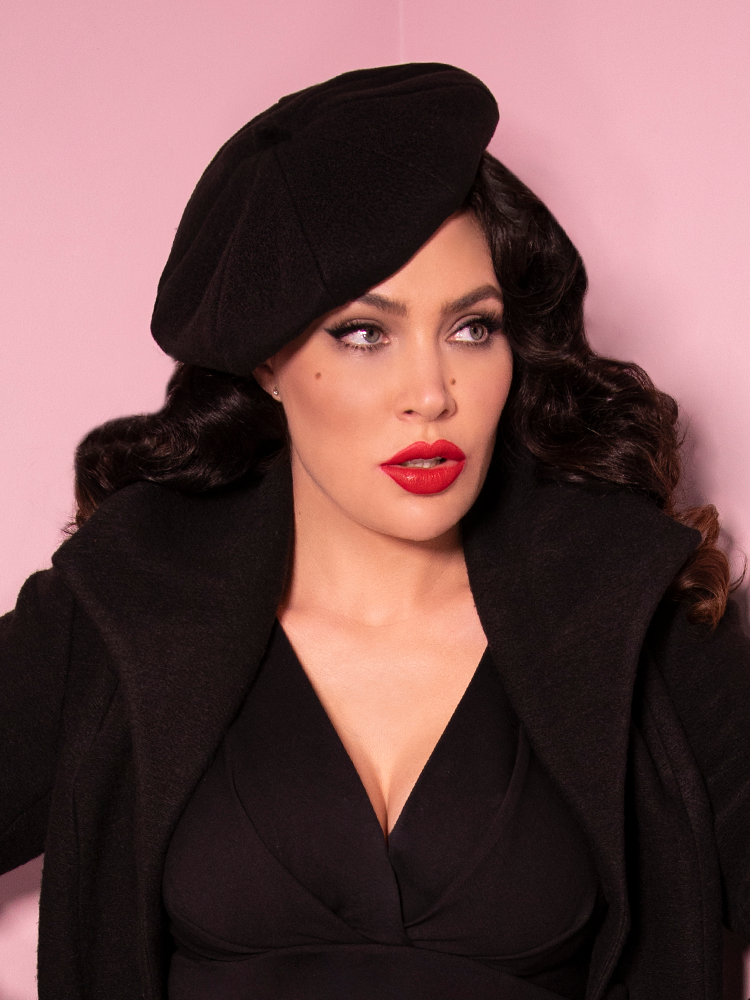 Close-up image of Micheline Pitt in an all black retro outfit including the Starlet Beret.