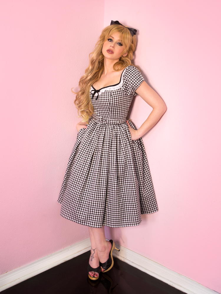 Blonde model wearing the Bardot Beauty Dress in Black Gingham from Vixen Clothing.