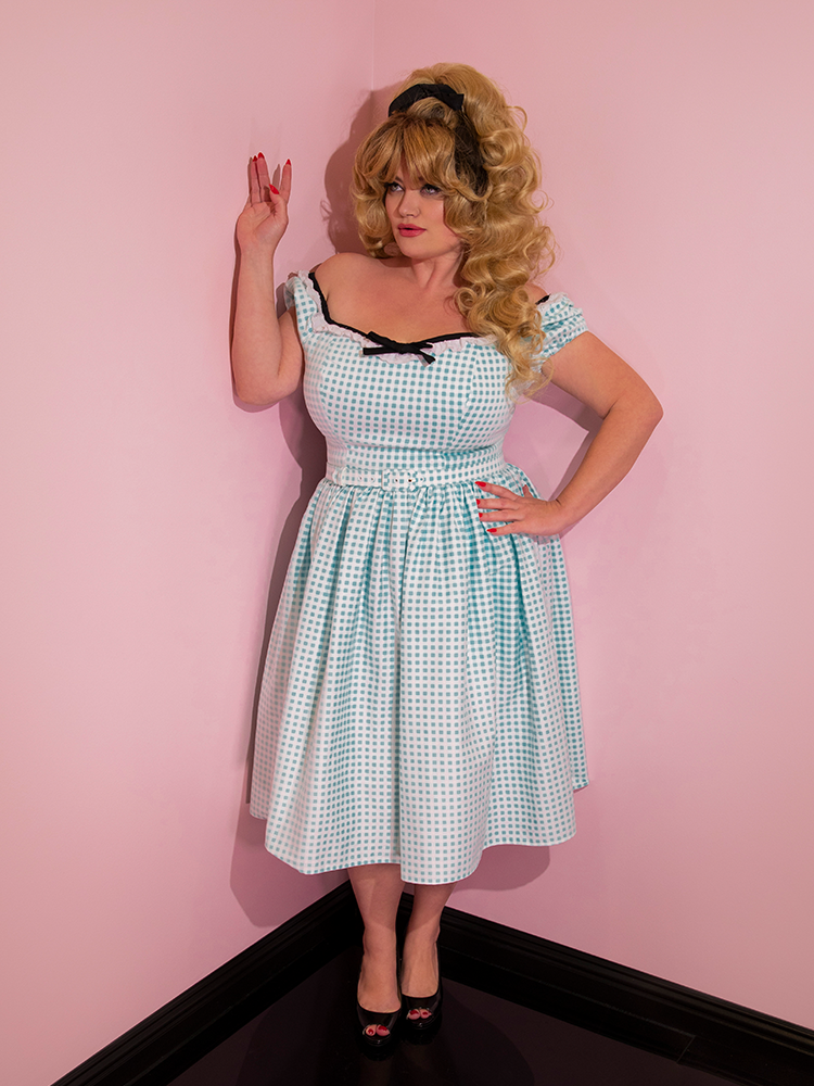 Full length shot of Blondie posing in a new vintage inspired dress.
