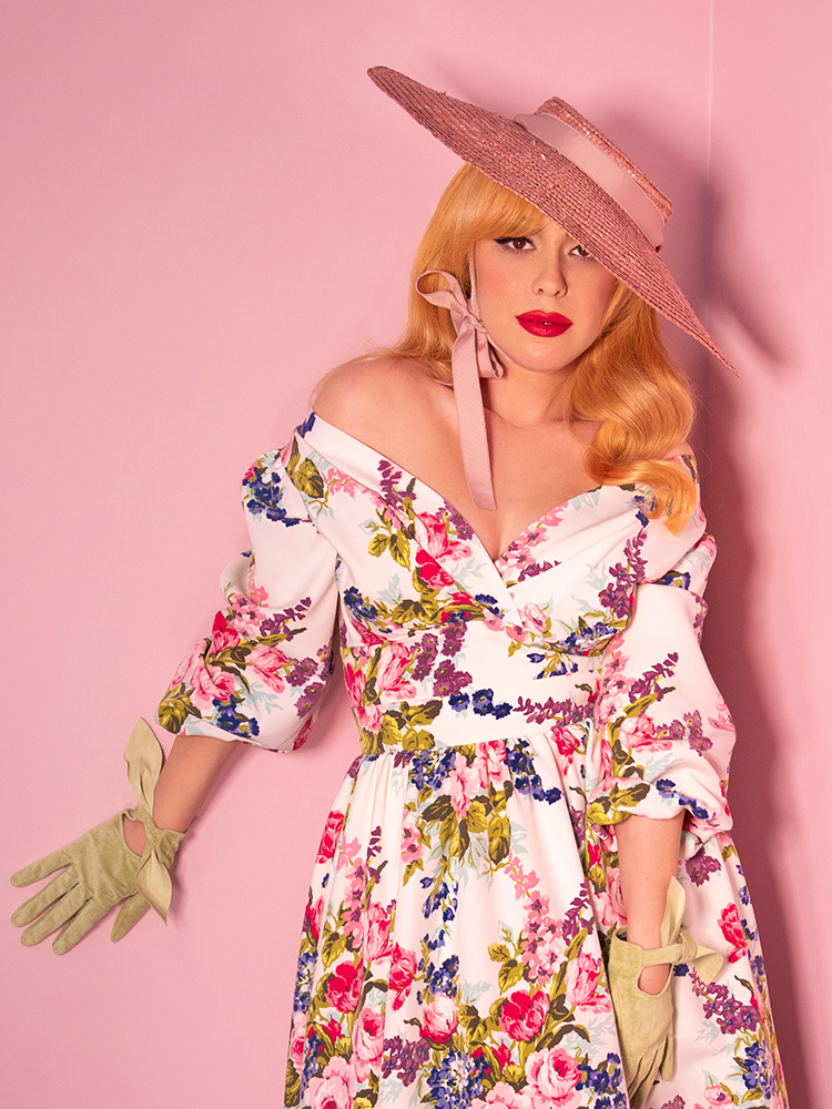 Blonde model wearing a vintage style flora blouse