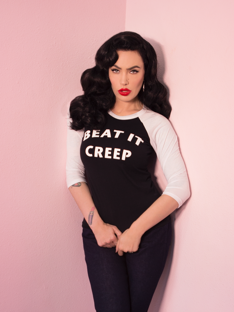 Micheline Pitt looking tough while modeling the Beat It Creep raglan t-shirt by Vixen Clothing.