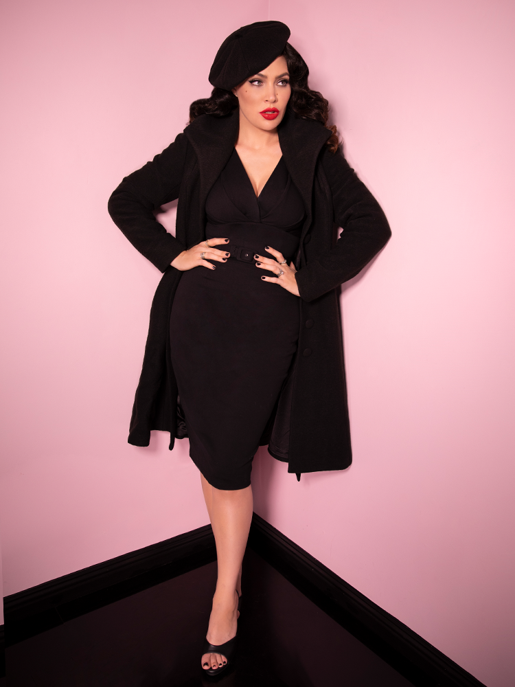 Micheline Pitt looks ready to take charge in an all black outfit highlighted by the Starlet Swing Coat in Black - a retro inspired long coat.