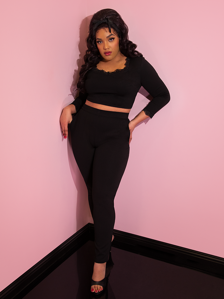 Ashleeta modeling the Vixen Clothing black ponte cigarette pants paired with a matching crop top.