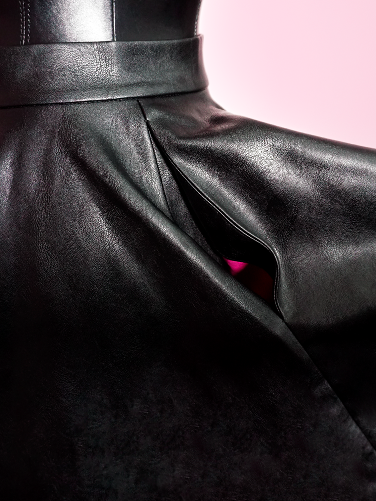 Close-up shot of the material on the vintage inspired Bad Girl Circle Skirt in Vegan Leather from Vixen Clothing.