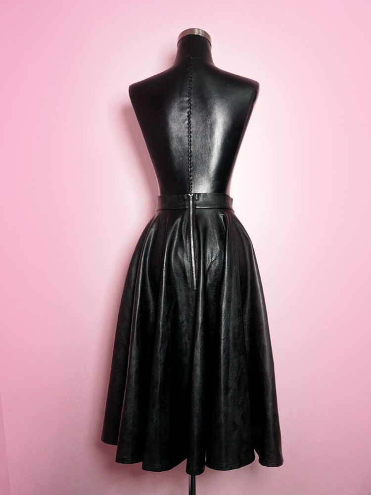 Product shot of the Bad Girl Circle Skirt in Vegan Leather displayed on a mannequin.