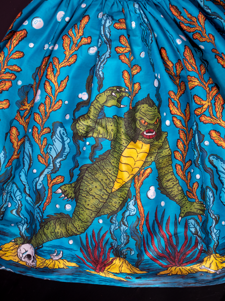 Close-up of the design of the Vixen Swing Skirt in Swamp Monster Print.