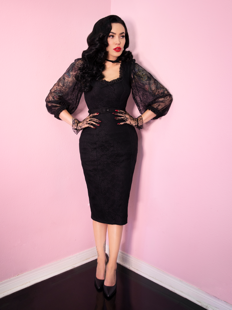 Full body shot of Micheline Pitt modeling the latest retro inspired dress release from Vixen Clothing.