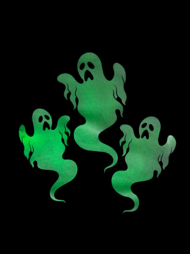 Up close shot of the glow in the dark ghost print featured on this retro clothing top from Vixen.