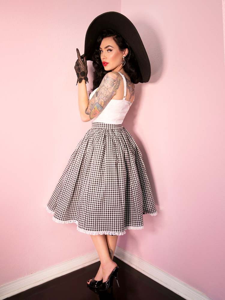 Micheline Pitt wearing a black and white gingham print skirt along with the Maneater Top in White - the latest retro inspired clothing release from Vixen Clothing.