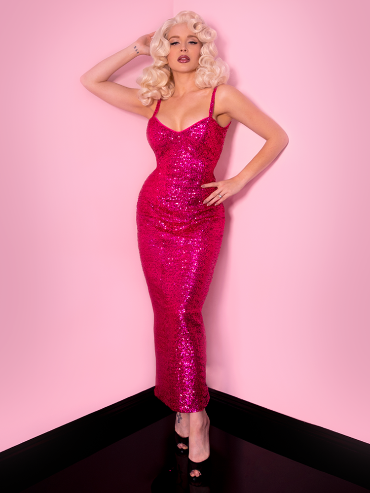 Marilyn Monroe lookalike model wearing a vintage style dress named the Glitz & Glamour Dress in Hot Pink Sequins.
