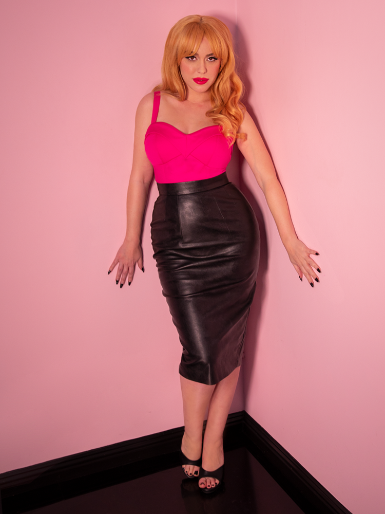 "Full body shot of Linda seductively wearing the retro inspired top dubbed the ""Maneater Top in Hot Pink"" along with the Vegan Leather skirt from Vixen Clothing."