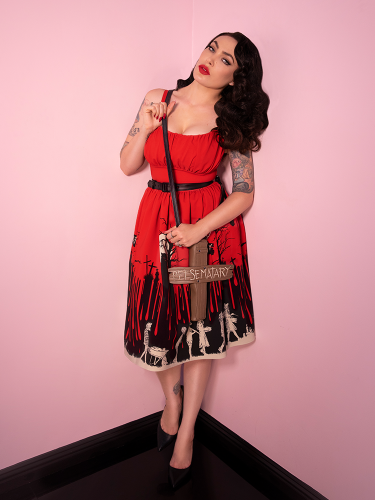 Micheline Pitt shows off the Pet Sematary Cross bag purse to go along with the blood red Pet Sematary Ingenue Dress.