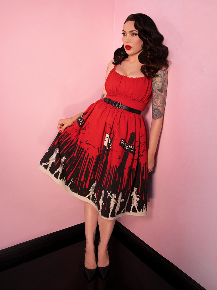 Micheline Pitt stares ahead off camera while showing off the vintage and horror inspired Pet Sematary Engenue Dress.