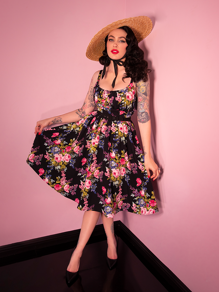 Vintage era black vintage floral print worn by model