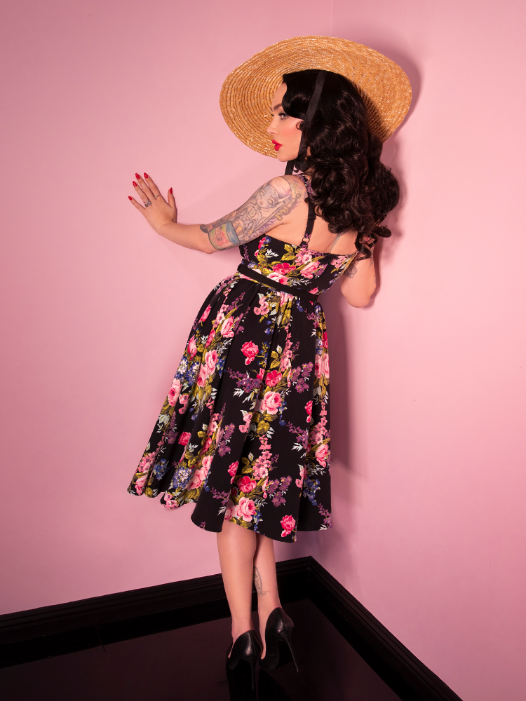 Shot of back of model wearing a floral print retro dress